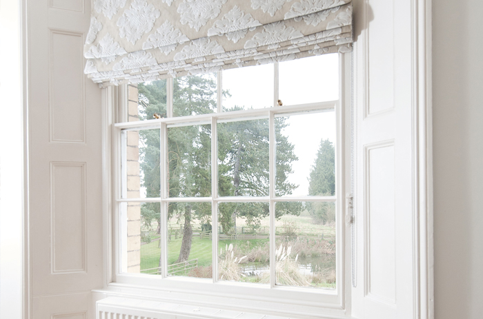 The window was dressed so that the Georgian window frame was exposed to its best advantage in this lovely vicarage in Surrey.