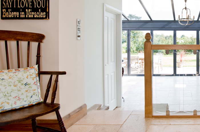 A stunning conservatory with folding doors was added to this listed building in Gloucestershire. The doors completely folded back which gave the feeling of bringing the outside into house.