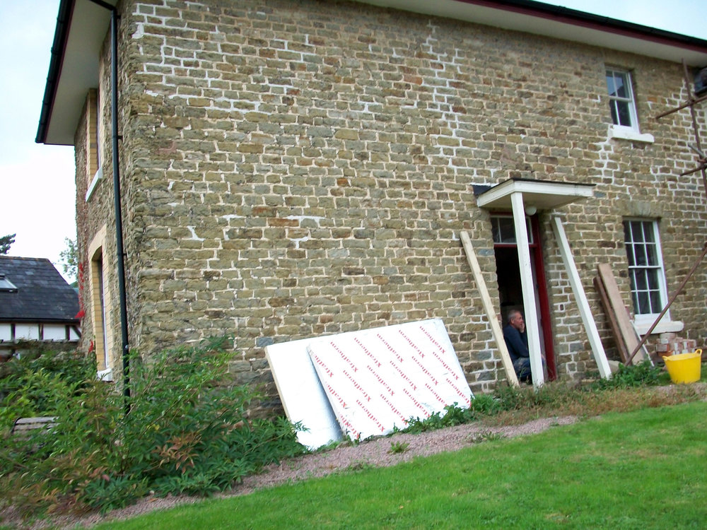 The exterior and front door before