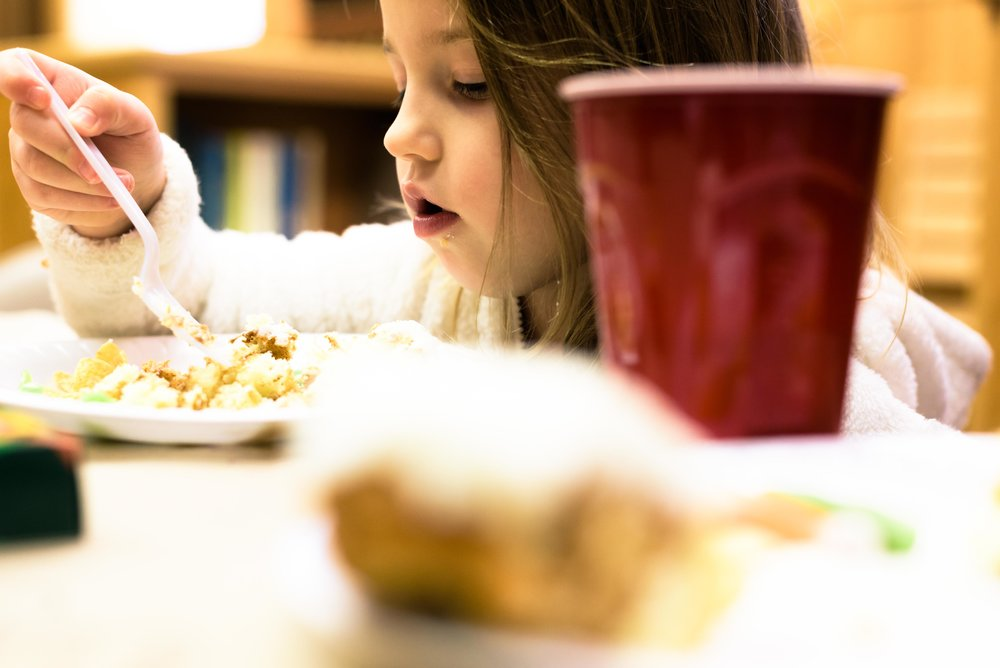 Emma joined her family for a cinnamon roll and soup in the Swedish Heritage room at the library during the meal.