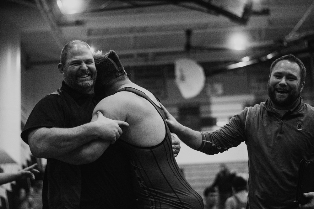 Victory hugs for Wampler from Coach Ben Elliot and Assistant Coach Adam Lackey