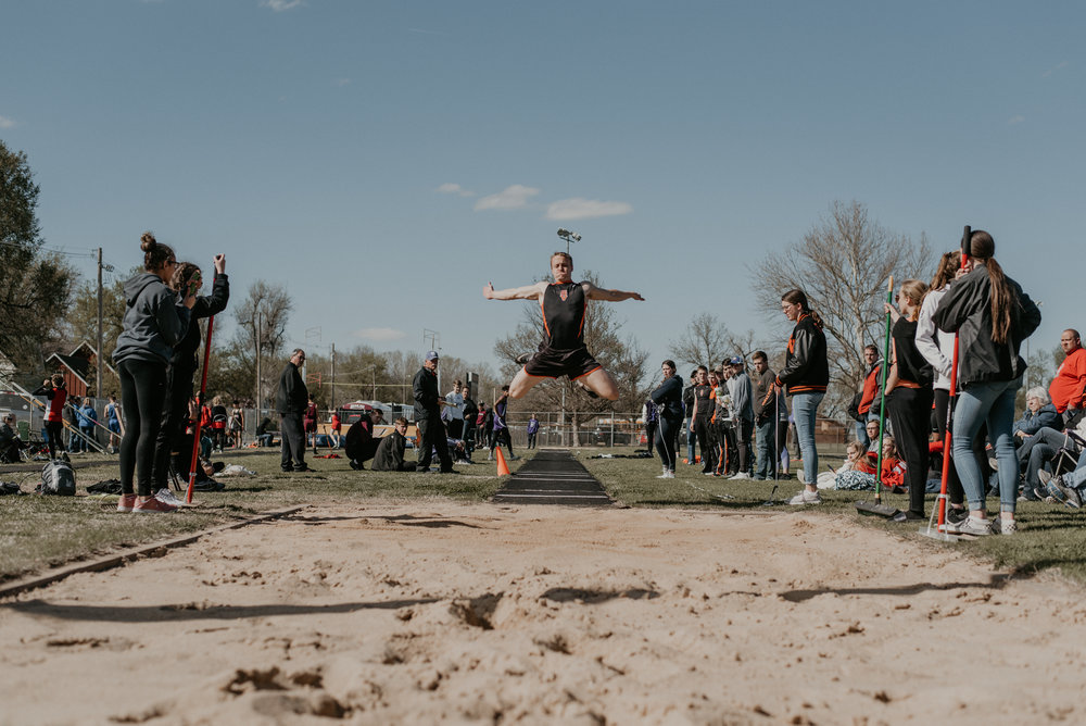 """Vikings' Carson Windholz takes to the air for a win in the triple jump with a tape measure 40' 6"""" jump to victory."""