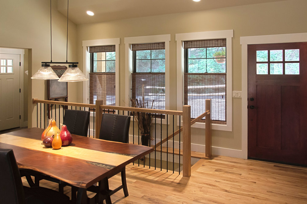 The wood accents on the interior, paired with the warm finishes on the cabinetry and countertops and wood tongue and groove ceilings, make this cozy home all the more inviting on the inside.