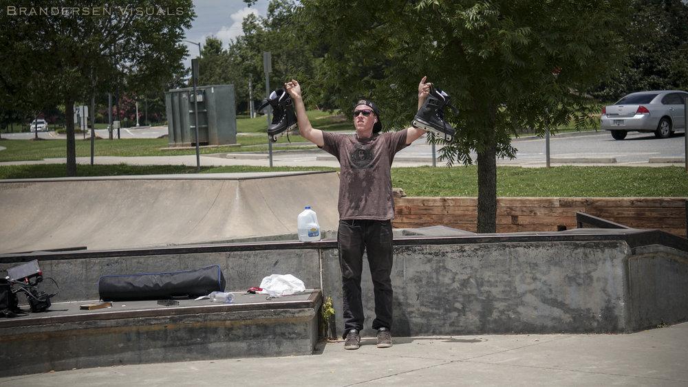 Patrick_Holding Skates Up.jpg