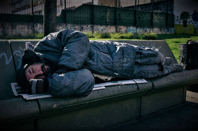Image of an Indigent sleeping on bench