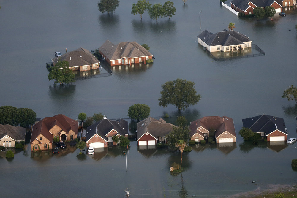 Floodwaters from Tropical Storm Harvey surround homes in Port Arthur, Texas. (AP Photo/Gerald Herbert)