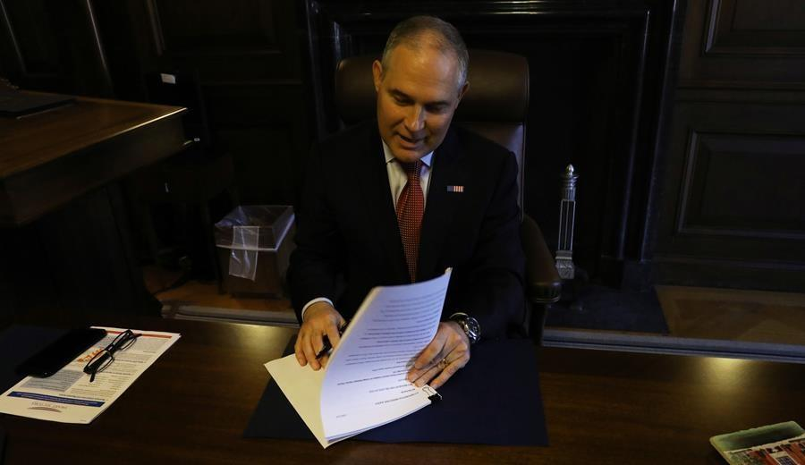 EPA Administrator Scott Pruitt signs the paperwork to revoke the Clean Power Plan. Photo: EPA
