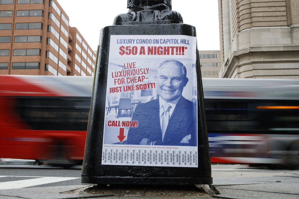 A sign criticizing Environmental Protection Agency Administrator Scott Pruitt is seen posted on the base of a utility pole on the corner of H Street NW and 13 Street NW in Washington, Friday, April 6, 2018. (AP Photo/Carolyn Kaster)