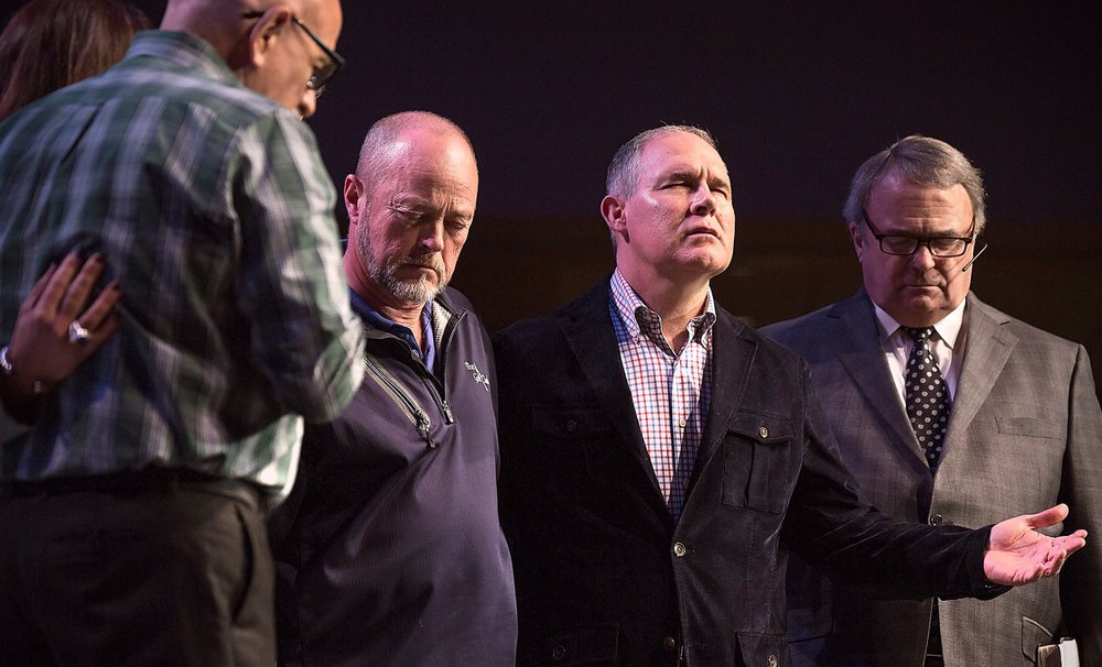 Scott Pruitt prays with members of his church before heading to Washington, DC to run the EPA. His long-time pastor, Nick Garland, is far right. Photo: First Baptist Church Broken Arrow / facebook