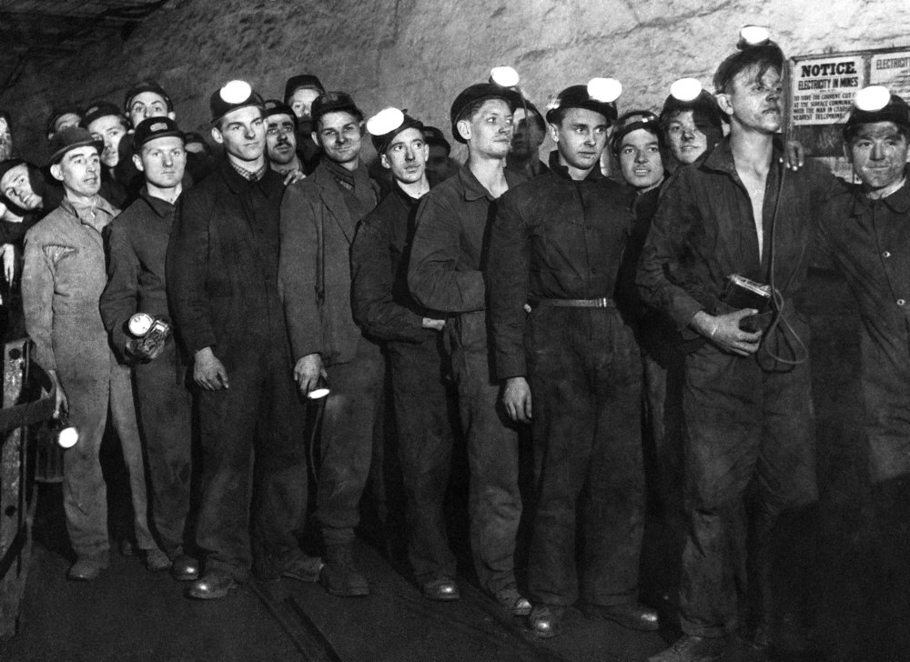 At the end of their shift, coal miners wait for the cage to take them up to the surface in a mine, in Canterbury, England, on Dec. 12, 1944. (AP Photo)