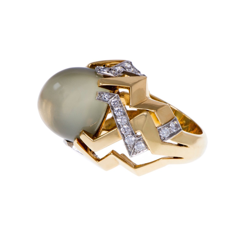 A ring of cabochon moonstone, diamonds, 18k gold, and platinum, Paloma Picasso for Tiffany & Co., U.S.A., c. 1980s. Size 8 ¼""