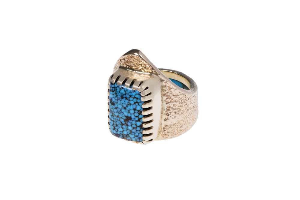 An Indian Mountain turquoise and 14k gold ring by Charles Loloma, Hopi, c. 1980s.