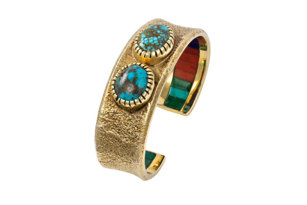 A cabochon turquoise and tufa cast 14 karat gold cuff, with channel set coral, lapis and turquoise interior, by Charles Loloma, c. 1975