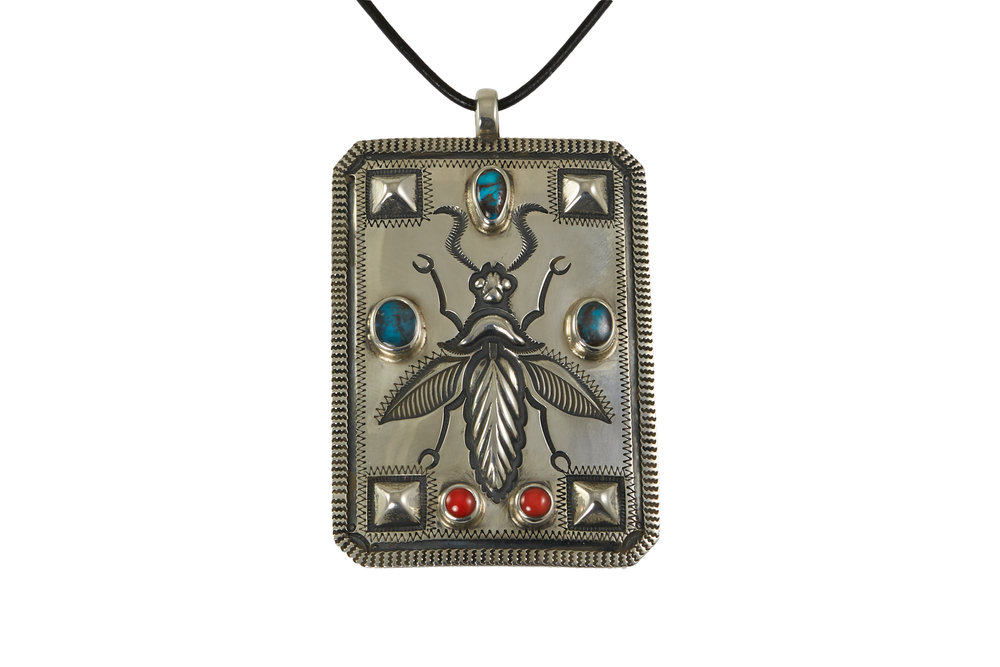 A Bisbee turquoise, coral, and sterling silver repouse bee pendant, by McKee Platero, c. 2015