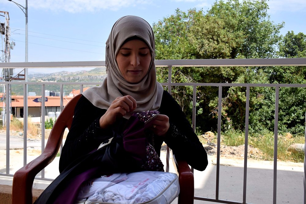 Sahar and two close friends used a loan to start a sewing business.  Photo courtesy of Kiva.org.