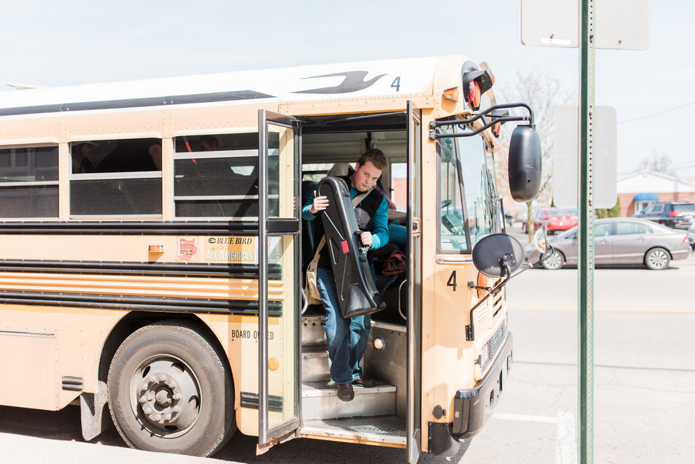 Student safely disembarking a school bus.