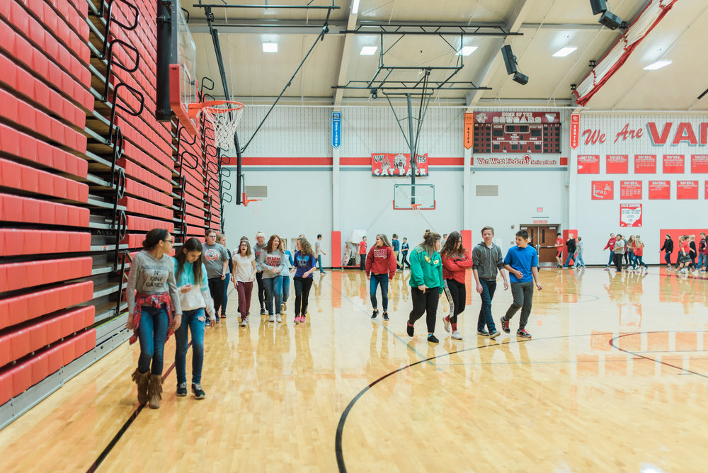 High School students walking in the gym.