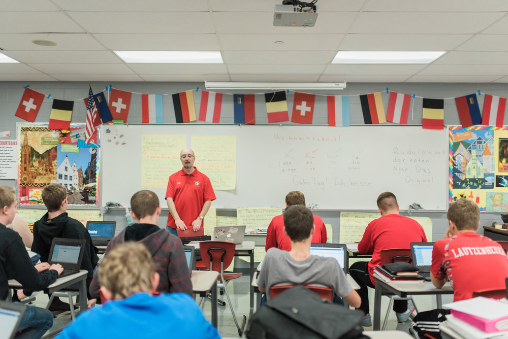 Students listening to their teacher during German class.