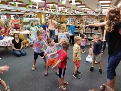 "Children participating in The Brumback Library's Summer Reading Program ended their morning with a ""Music and Movement"" session."