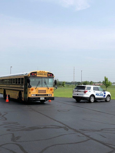 A school bus and police car.