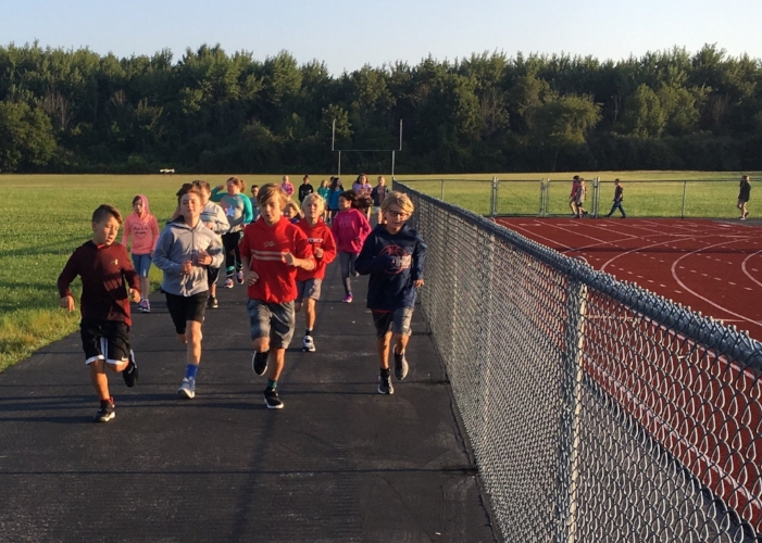 Students running to earn miles as part of the 100 Mile Club