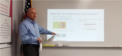 Chris Covey, Curriculum Director at Van Wert, reviews the State Report Card at the Van Wert Board of Education meeting Wednesday night.  (DHI Media/Julie Keirns)