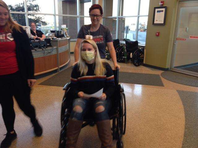 Student in wheelchair role-playing a sick patient during the influenza disaster drill at Van Wert Health