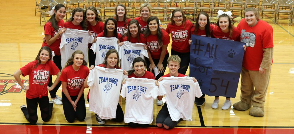 "VWHS cheerleaders hold up ""Team Riggy"" t-shirts"