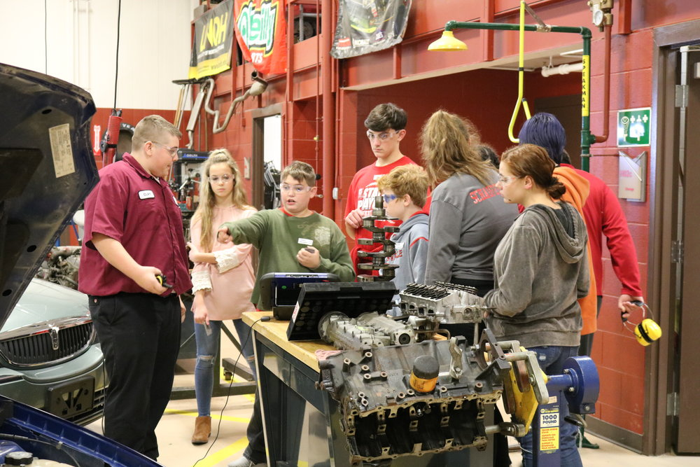 VWMS 8th graders tour Vantage's auto technology department.