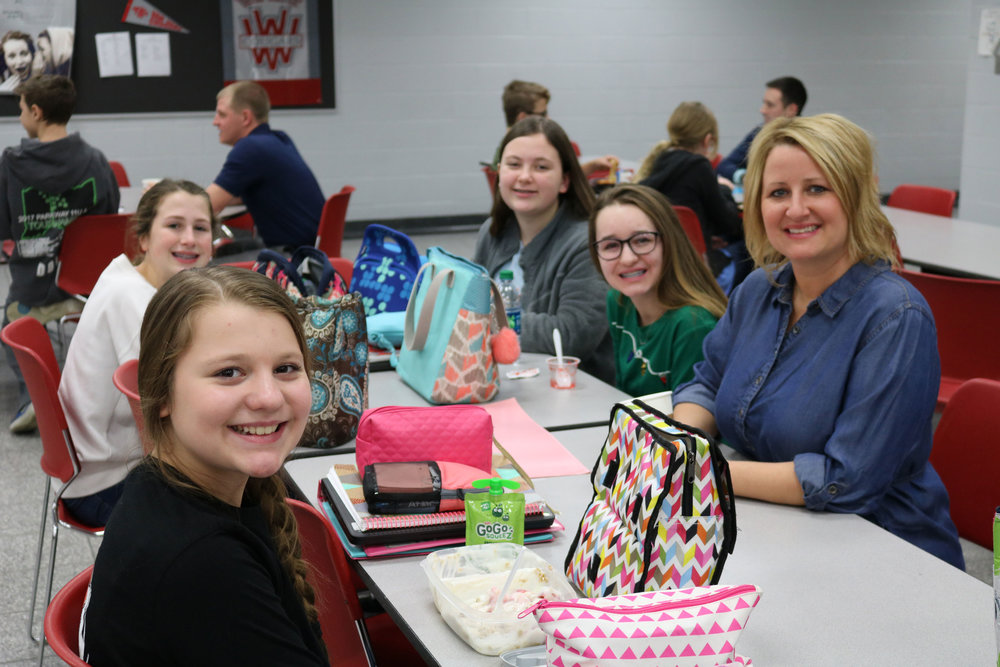 Michelle Gunter of Schrader Realty eats lunch and shares her work experience with a group of 7th grade girls.