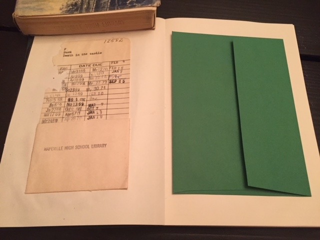 """Original library """"date due card"""" inside """"Death in the Castle,"""" a secret diary book journal.A premium green envelope has been affixed for your use in storing mementos."""