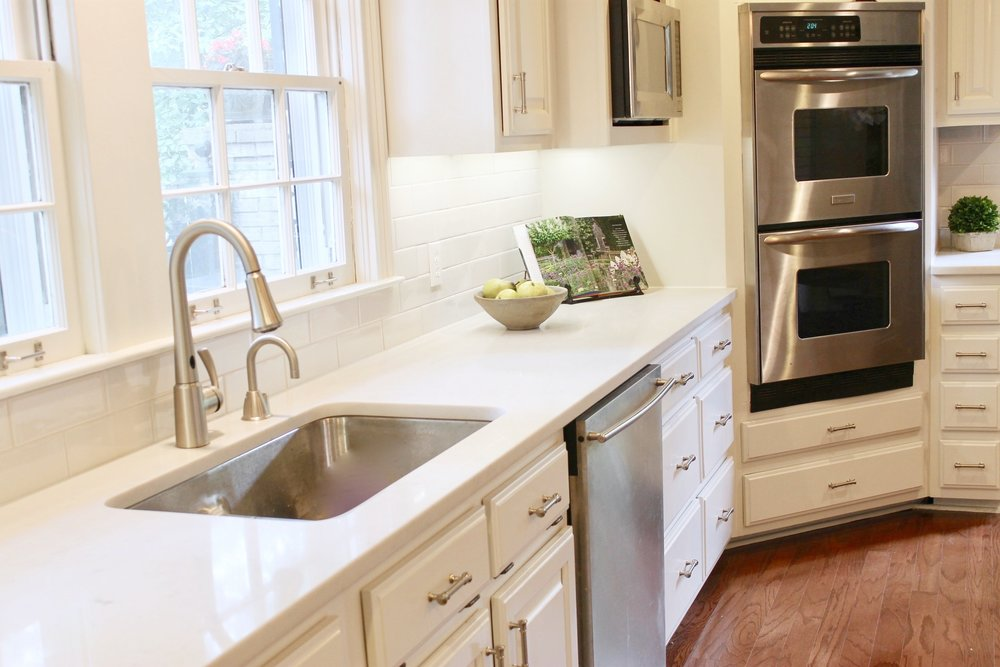 Prime Design Memphis, LLC - White Kitchen, White Quartz Countertops, Subway Tile Backlash, and Butcher Block Countertops