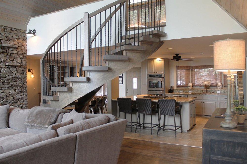 Prime Design Memphis, LLC - Arkansas Lake House, Living & Dining, White Walls, Taupe Trim, Sectional, Farm Table, Rustic Wood Ceiling