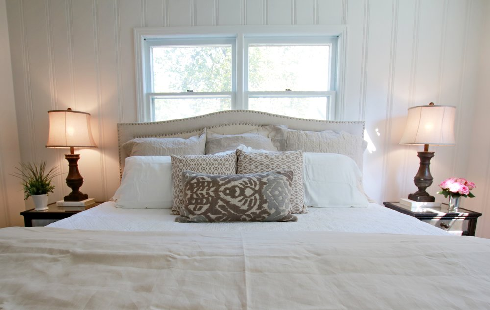 Prime Design Memphis, LLC - Master Bedroom, Sherwin Williams Pure White, Painted Knotty Pine Paneling, Hardwood Floors, Pottery Barn Headboard, Neutral