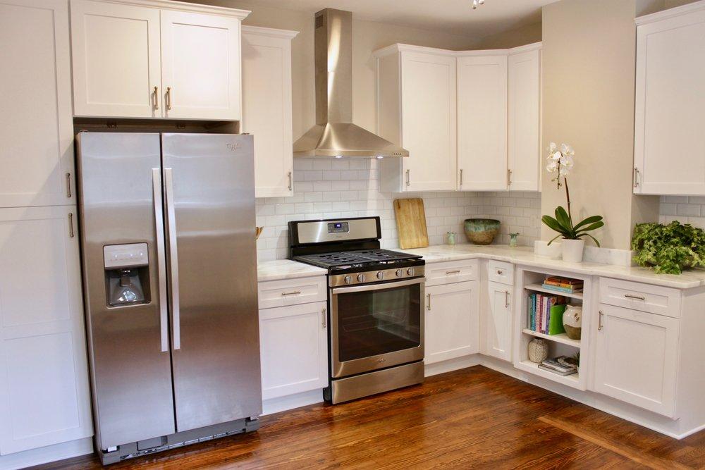 Prime Design Memphis, LLC - White kitchen, beveled subway tiles, shaker cabinets, hardwood floors