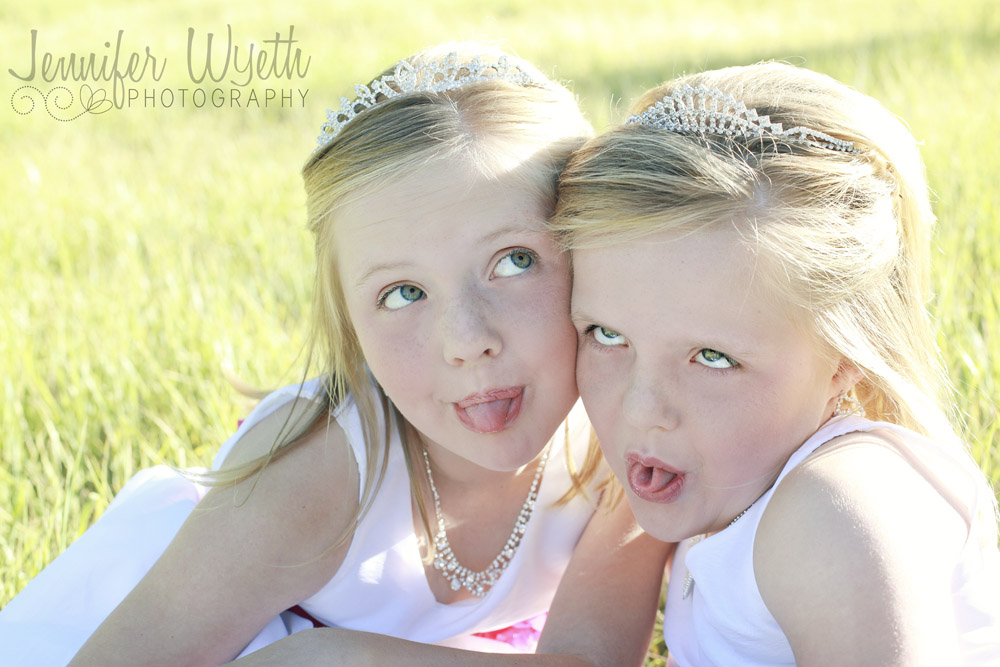 silly faces of baptized twins in the sun