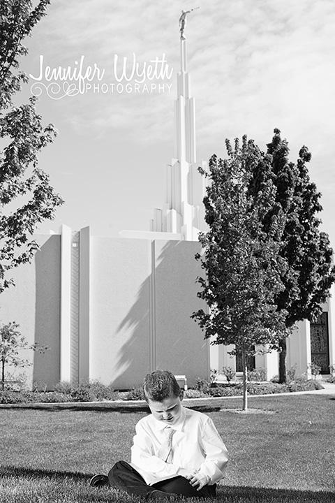 Boy reading scriptures outside of Mormon church