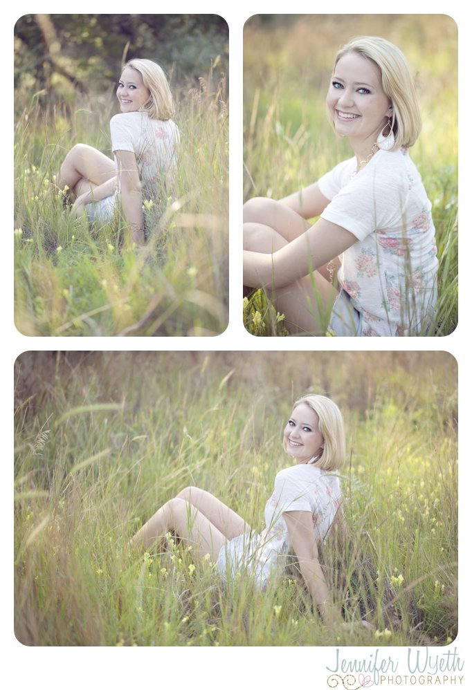 beautiful tall grass with a senior high school girl sitting in it