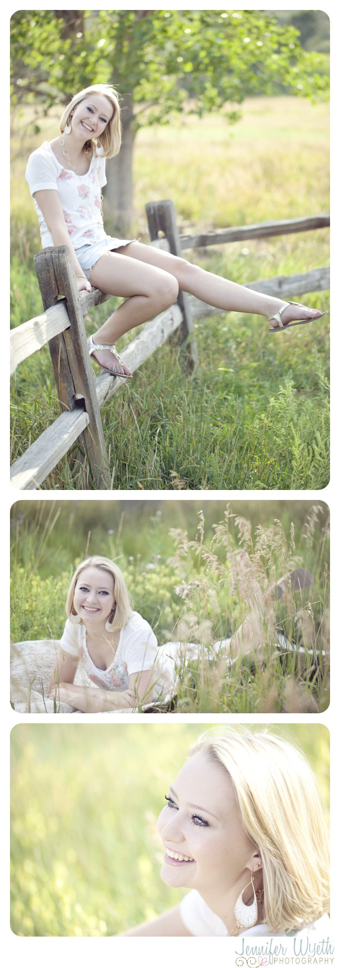senior girl sitting and laughing on a split rail fence.