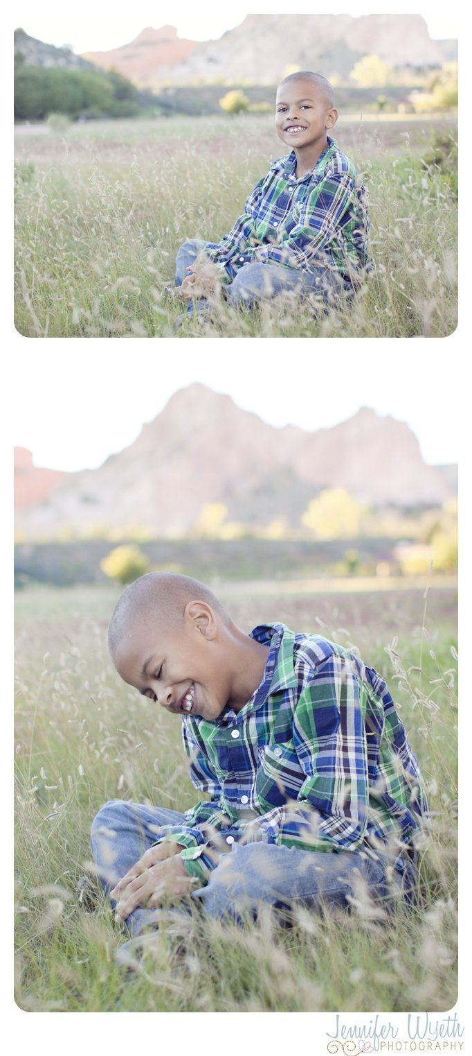 laughing boy with garden of the gods in background