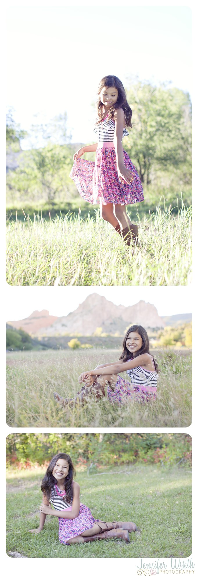girl spins and sits in a field with Garden of the Gods in the background