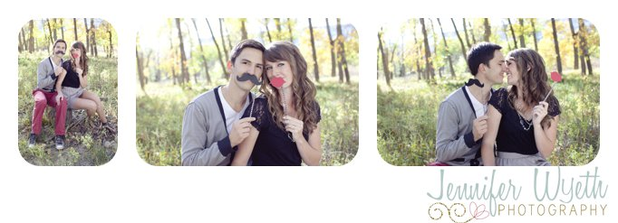 couple snuggles up using photo props