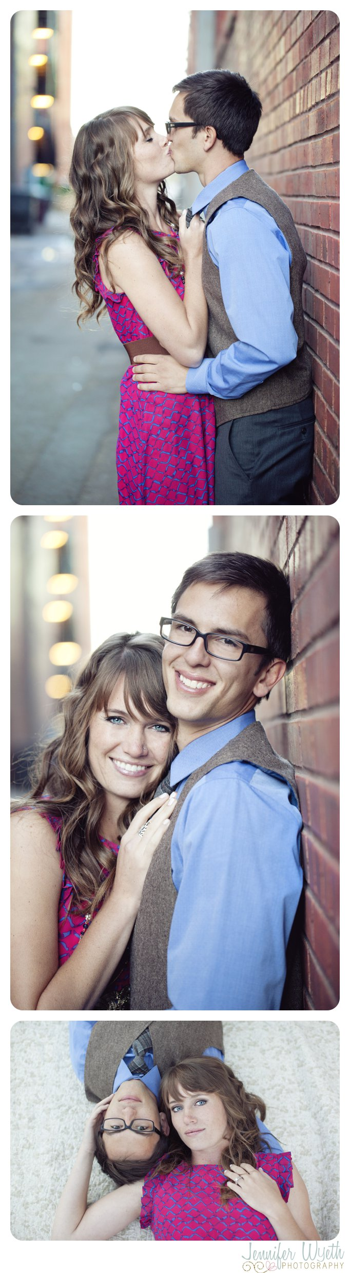couple snuggles up against a red brick wall in alley