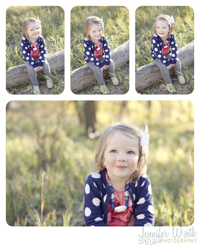 tall green grass frames a beautiful little girl sitting in the forest