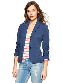 Jeans and a blazer over a coral striped top for a sophisticated casual look in senior pictures