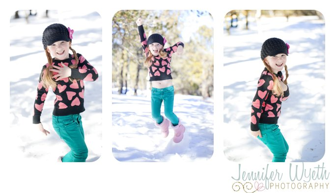 little girl Jumping around in the snow and laughing