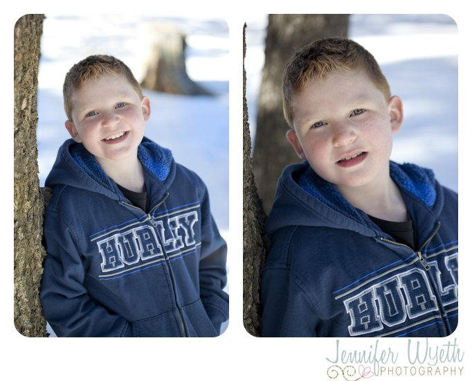 8 year old boy in blue sweater smiles in snow