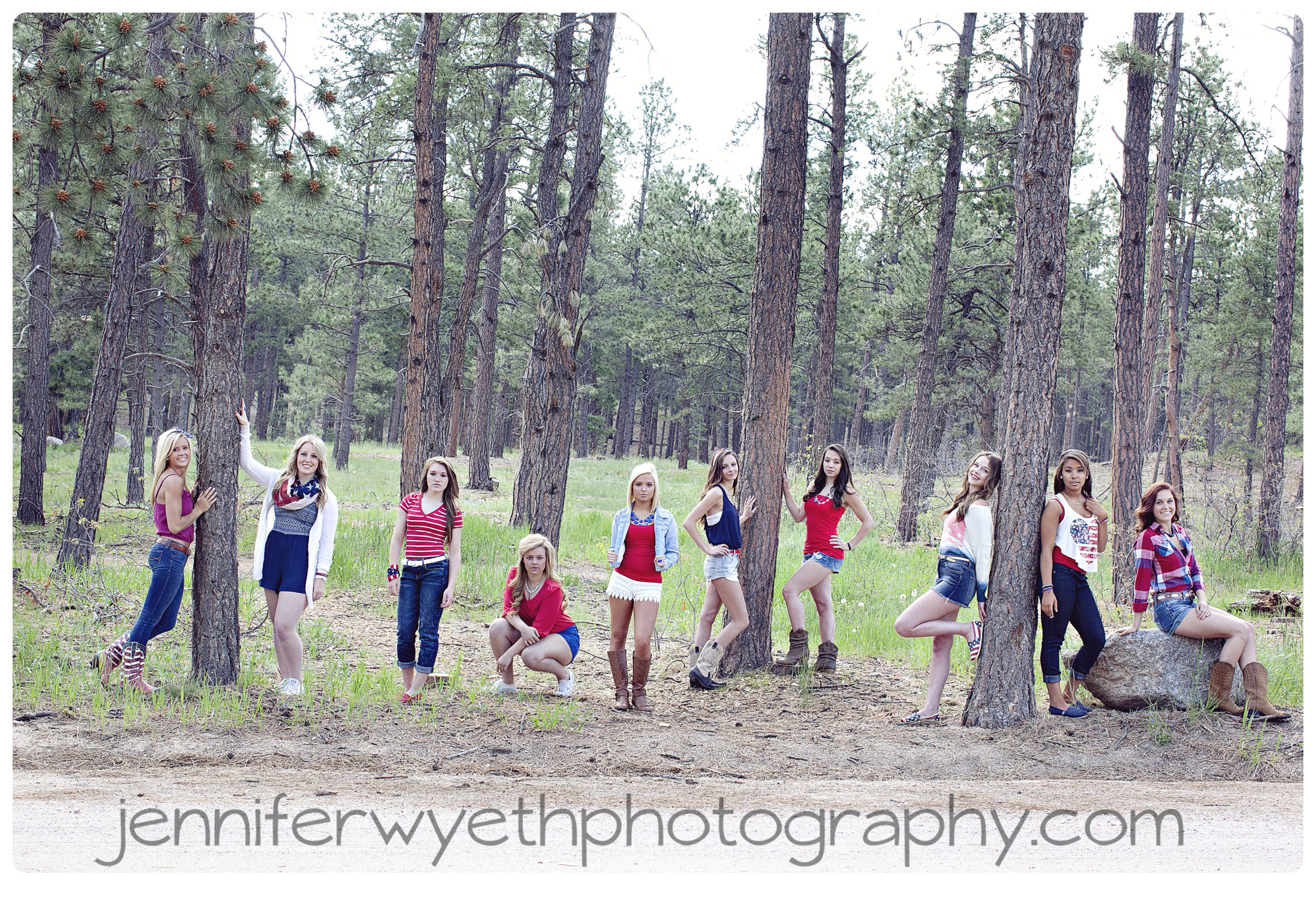 ten girls pose in forest showing sass wearing red white and blue