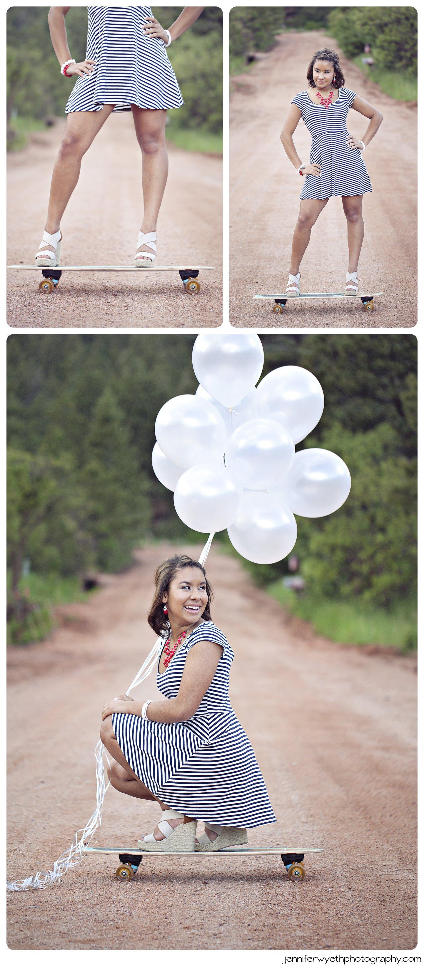 girl rides skateboard while she holds bushel of balloons