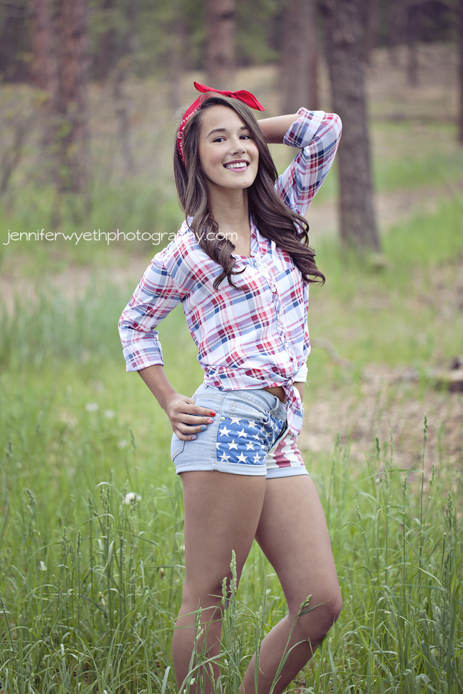 junior girl strikes pose with red bandana and patriotic clothing